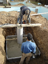 Photo: Column is formed from plastic sheeting nailed to 2 2x4s and the wet concrete makes the cylinder.