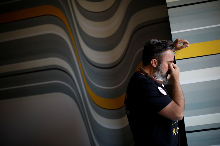 Manuel Oliver, whose son was killed in one of the US's many mass school shootings, cries in his Los Angeles hotel room before painting a mural to commemorate the victims and promote gun control. Minutes before leaving the hotel room to paint the mural, Oliver put on his son's headphones and played his favourite music. Almost immediately, he started to cry and had to take them off.