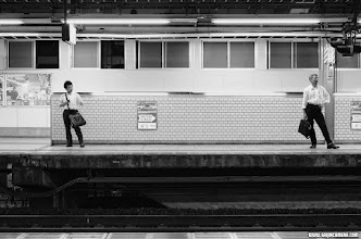 Photo: 2 men waiting for the train to come