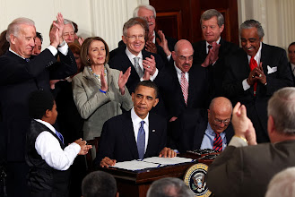 Photo: WASHINGTON - MARCH 23:  U.S. President Barack Obama (C) is applauded after signing the Affordable Health Care for America Act during a ceremony with fellow Democrats in the East Room of the White House March 23, 2010 in Washington, DC. The historic bill was passed by the House of Representatives Sunday after a 14-month-long political battle that left the legislation without a single Republican vote.  (Photo by Win McNamee/Getty Images) *** Local Caption *** Nancy Pelosi;Joe Biden;Barack Obama