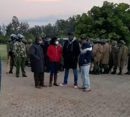 Police officers and some residents outside the home of Kapseret MP during a raid by security officers who were sent to arrest him on September 12th