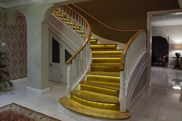 The imposing staircase leading to the suites above