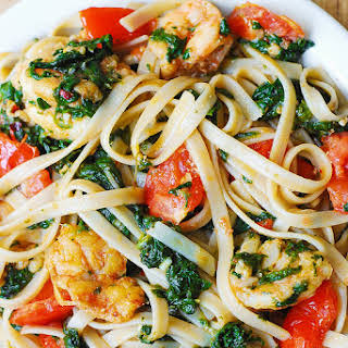 Shrimp, Tomato, And Spinach Pasta In Garlic Butter Sauce.