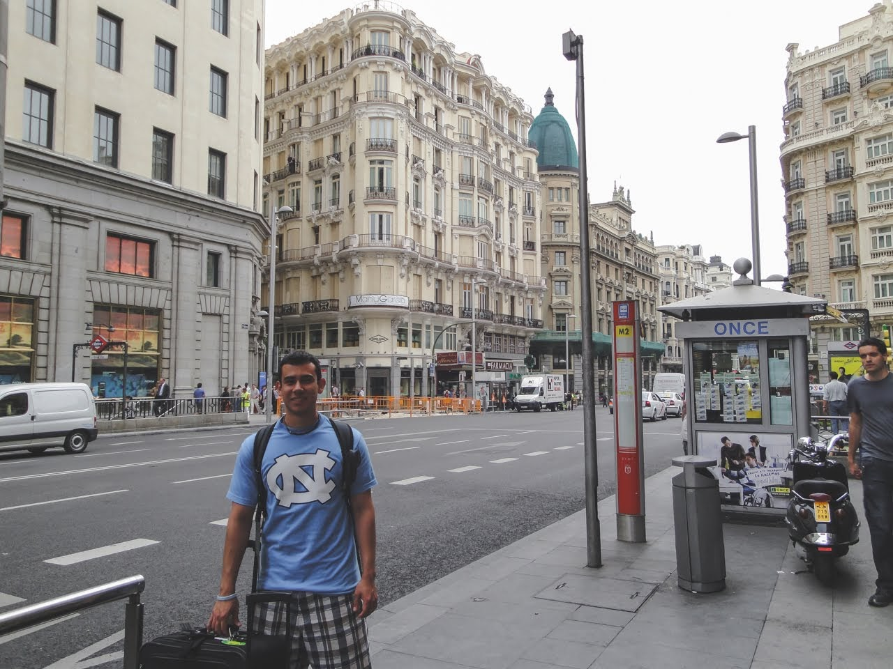 Standing along the sidewalk of La Gran Via, wearing a UNC Chapel Hill t-shirt