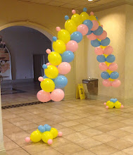 Photo: fishbone arch with links tipped with small balloons
