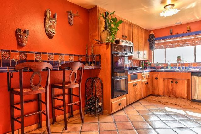 This full on Mexican kitchen has style love the retro appliances