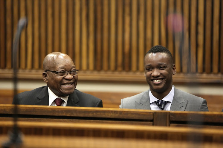 Former president Jacob Zuma who will not be questioning witnesses at the state capture commission of inquiry sits next to his son Duduzane Zuma who wants to testify. This is file photo of Zuma sitting in court with his son who faces charges of culpable homicide.