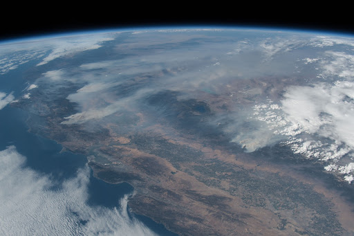 Wildfires are seen to the north and east of the San Francisco Bay Area as the International Space Station orbited above the Pacific Ocean.