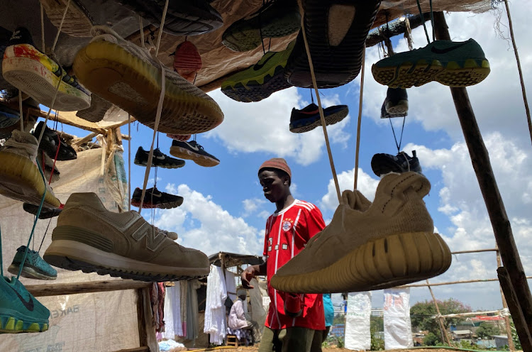 A vendor arranges second-hand shoes for sale at an open stall during Good Friday, after the government banned gatherings amid concerns about the spread of coronavirus disease at the Kibera slums in Nairobi, Kenya on April 2 2021. Picture: REUTERS/THOMAS MUKOYA