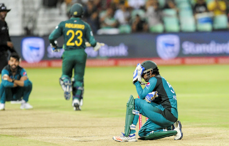 Pakistan captain Sarfraz Ahmed looks dejected behind the stumps as South Africa's Andile Phehlukwayo piled on the runs during the second ODI match at Durban's Kingsmead Stadium on January 22 2019.