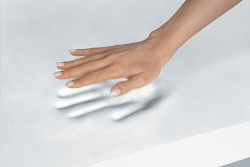 Memory foam mattress with a hand showing it's capabilities