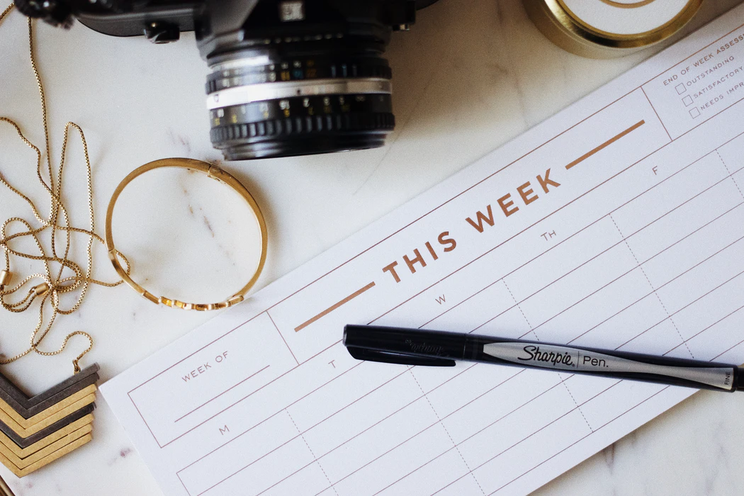 Weekly planner and pen