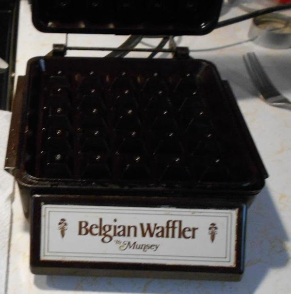 Heat waffle iron. Brush a little oil on to the iron ...top and bottom. Measure all...
