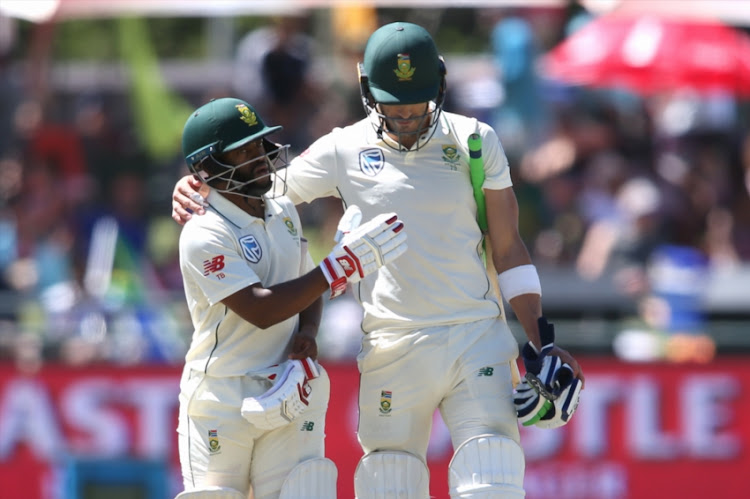 Temba Bavuma of South Africa and South African captain Faf du Plessis congratulate each other for reaching tea during day 2 of the 2nd Castle Lager Test match between South Africa and Pakistan at PPC Newlands on January 04, 2019 in Cape Town, South Africa.