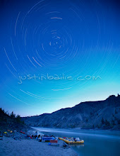 Photo: Star trails over the Fraser River and raft camp. British Columbia, Canada.