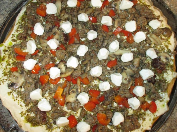 When the oven is fully up to temperature, add the toppings and cheese. ...