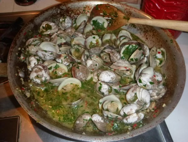 Add the clams to your sauce,cover and cook ,shaking pan occasionally, until clams open,about...