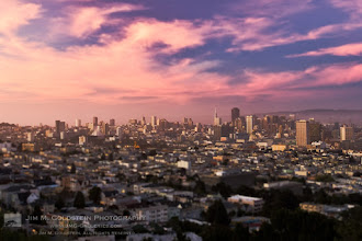 Photo: San Francisco Sunset Mother Nature sure has a way of making big things look small. San Francisco dwarfed by a giant beautiful sunset sky.