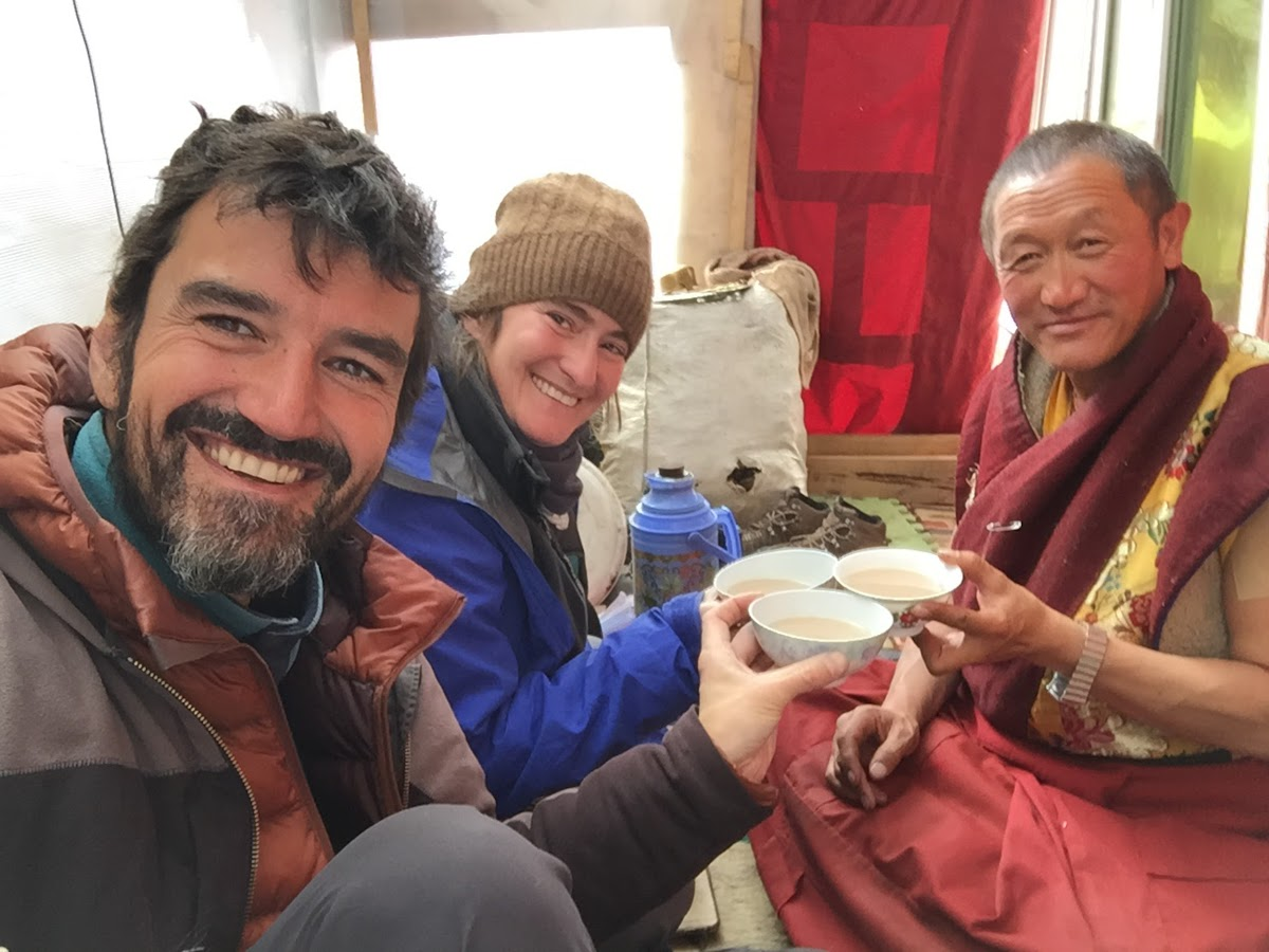 China. Tibetan Region. Sharing a meal with a Tibetan Monk in Yarchen