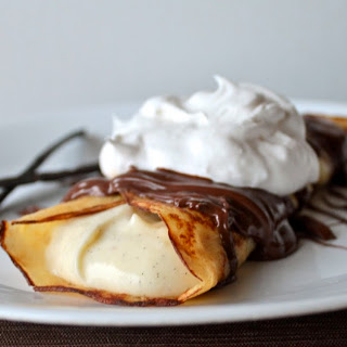 Vanilla Bean Crepes With Vanilla Bean Custard and Warm Nutella Drizzle.