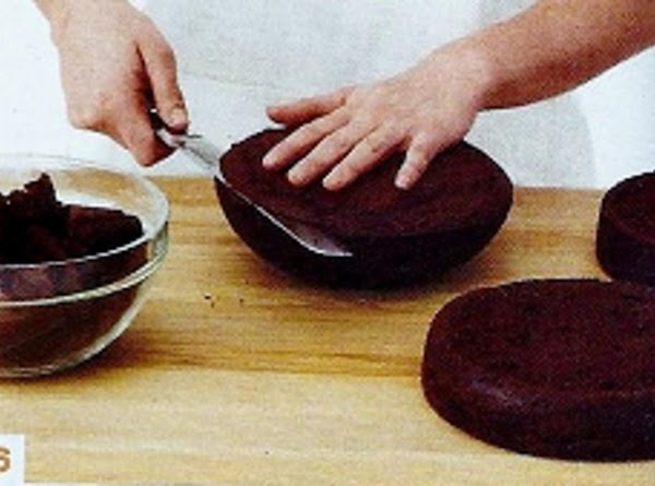 Trim the top of 1 round cake and the flat side of the bowl...