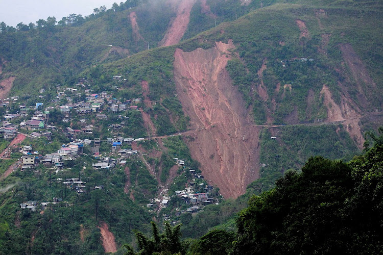 A view of a landslide, caused by Typhoon Mangkhut, that buried people at a mining camp in Itogon, Benguet, in the Philippines, September 16 2018. Picture: REUTERS/HARLEY PALANGCHAO