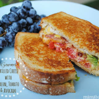 Gourmet Grilled Cheese with Bacon, Tomato, and Avocado.