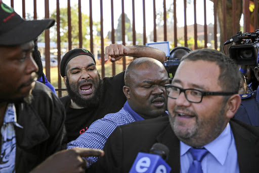 Members of the Black First Land First heckle AfriForum chief executive officer Kallie Kriel.