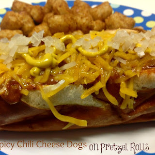 Spicy Chili Cheese Dogs on Pretzel Rolls.