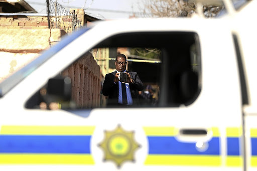 Education MEC Panyaza Lesufi takes a picture at the scene where a grade 8 pupil was killed at Forest High School in Turffontein, south of Johannesburg, yesterday./ Thapelo Morebudi