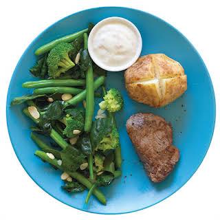 Steak With Horseradish Cream, Baked Potato And Greens.