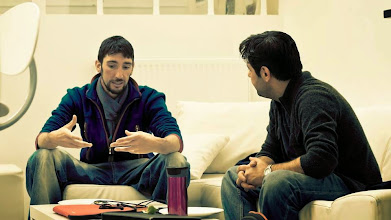 Photo: Tibi and Eimhin talking