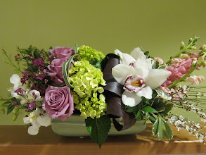 Photo: Add a touch of elegance to your home or impress the host of your Easter dinner with this highly stylized fresh floral arrangement. Order today!