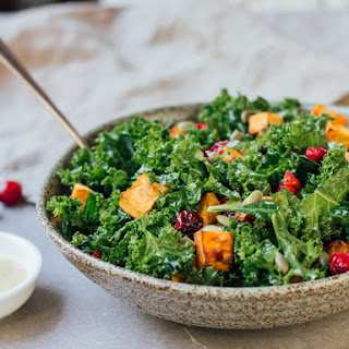Kale Salad With Roasted Sweet Potato And Cranberries.