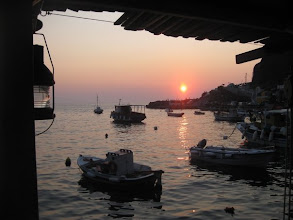 Photo: Ammoudi harbor at sunset