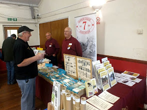 Photo: 008 7mm NGA Chairman Neil Smith and colleague with the Association's Modelling Goods stand .