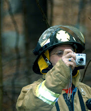 Photo: Norm Cummings SPECTRUM/Gaylordsville firefither Tom Hogan/Tucker Hogan photographs Jan. 13, 2007 drill at Mill Pond in Sherman