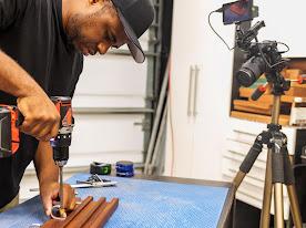 A man using a power drill
