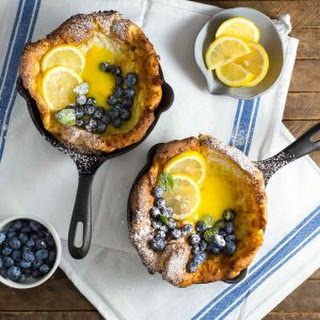 Mini Dutch Babies with Lemon Curd and Blueberries.