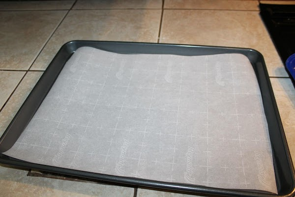 Line bottom of jelly roll pan or cookie sheet with parchment paper.
