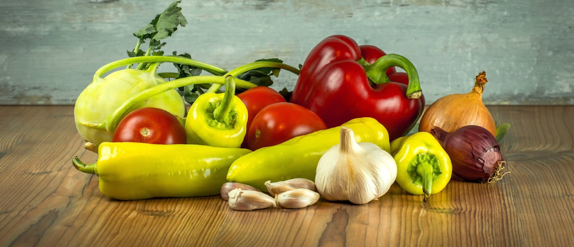 a variety of fresh vegetables from green and red peppers to onions