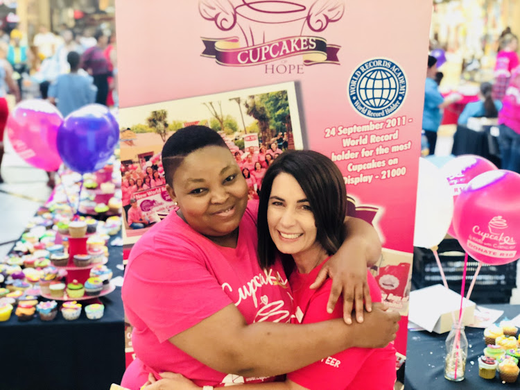 Cupcakes of Hope founder Sandy Cipriano and cupcake volunteer Aldah Bungane.