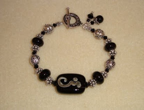 Photo: lampwork glass & sterling silver bracelet
