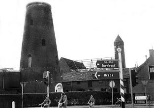 Photo: 1974 - Ringbaan Zuid,  restant van de molen van de meelfabriek schraven--eijsbouts. op de achtergrond de aAfbraak de kerk Broekhoven II.