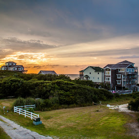 Sound Sunset by Angela Moore - Landscapes Travel ( water, clouds, beach house, colorful, sunset, fences )