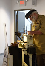 Photo: And here's John at the lathe...