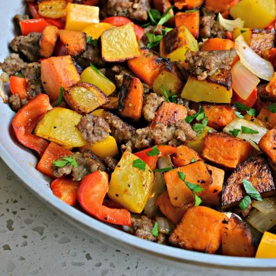 Perfect For Any Time Of The Day This Tasty Sweet Potato Hash Is Loaded With Wholesome And Hearty Ingredients Like Ground Pork Sausage, Sweet Bell Peppers And Onions.  For A Complete Protein Packed Meal Add The Eggs And Bake.
