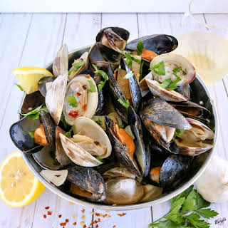 Clams and Mussels in Garlic Butter Wine Sauce.