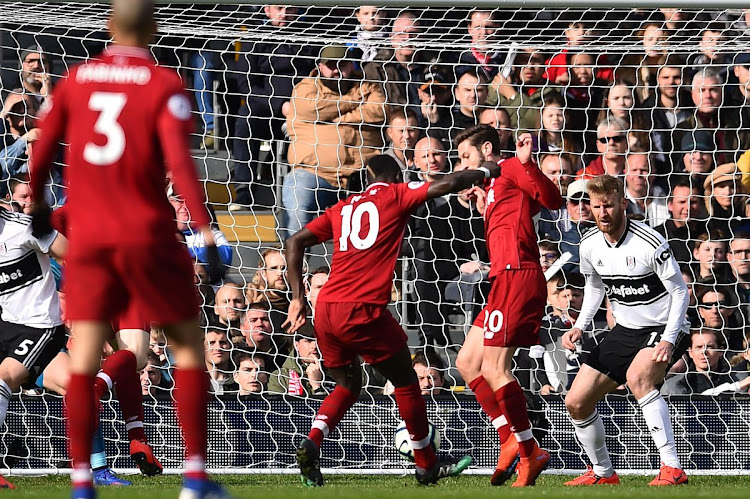 Liverpool forward Sadio Mane scores his 17th Premier League goal during the 2-1 win over Fulhal at Craven Cottage in London on March 17 2019.