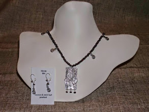 Photo: <BEREHYNYA> {Great Goddess Protectress} unique one-of-a-kind statement jewellery by Luba Bilash ART & ADORNMENT  Swirl leaf pendant/earrings, garnets, sterling silver SOLD/ПРОДАНИЙ